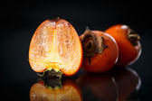 Ripe persimmon — Stock Photo