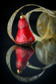 Christmas bell with gold ribbon — Stock Photo