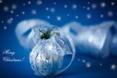 Christmas card with silver balls and ribbon — Stock Photo