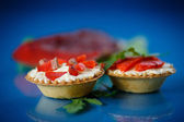 Tartlets filled with red fish — Stock Photo