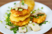Potato pancakes with herring and onion — Stock Photo