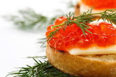 Slice of bread with red caviar — Stock Photo