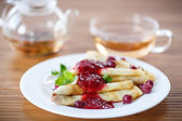 Pancakes with jam and berries — Stock Photo