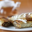 Pancakes stuffed with mushrooms and cabbage — Stock Photo #38903395
