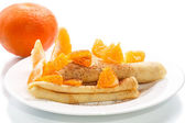 Pancakes with tangerines — Stock Photo