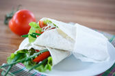 Pita bread with lettuce and vegetables — Stock Photo