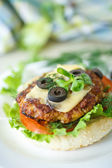 Tasty hamburger with lettuce and tomato — Stock Photo