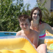 Two teenagers swimming in the pool — Stock Photo #46890859