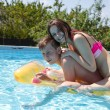 Two teenagers swimming in the pool — Stock Photo #46890861