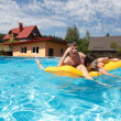 Two teenagers swimming in the pool — Stock Photo #46890871