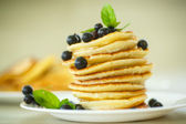 Pancakes with currants — Stock Photo