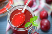 Cherry plum jam with a bank — Stock Photo