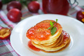 Pancakes with plum jam — Stock Photo