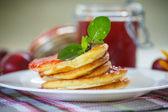 Pancakes with plum jam — Stock Photo