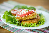 Zucchini fritters with tomatoes — Stock Photo