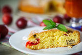 Biscuit cake with cherry plums  — Stock Photo