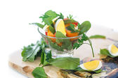 Sorrel salad and tomatoes with egg — Stock Photo