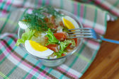 Salad with salmon and rice with vegetables — Stock Photo