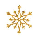 Altın kar tanesi üzerinde beyaz izole. noel ağacı süsle. — Stok fotoğraf