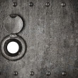 Peep hole in grunge metal armored door — Stock Photo