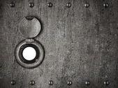 Peep hole in grunge metal armored door — Stock Photo
