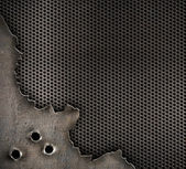 Metal with bullet holes military background — Stock Photo