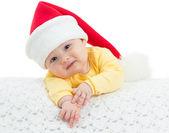 Baby girl in Santa's hat on white background — Stock Photo