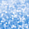 Stock Photo: Abstract blue sparkles defocused background