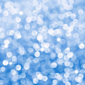 Abstract blue sparkles defocused background — Stock Photo