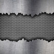 Silver hexagon metal grate background in ripped hole — Photo