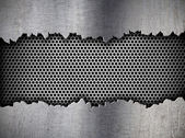 Silver hexagon metal grate background in ripped hole — Stock fotografie