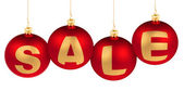 Sale word made of christmas tree decoration red balls for winter — Stock Photo