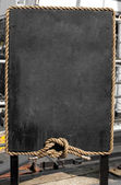 Grunge blackboard with rope frame outdoor as a background for yo — Stock Photo