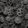 Stock Photo: Many old rusty metal gears or machine parts