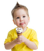 Kid eating ice cream isolated on white — Stock Photo