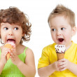 Children or kids, little girl and boy eating ice cream isolated — Stock Photo #14858139