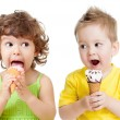 Stock Photo: Children or kids, little girl and boy eating ice cream isolated