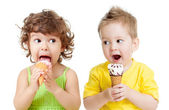 Children or kids, little girl and boy eating ice cream isolated — 图库照片