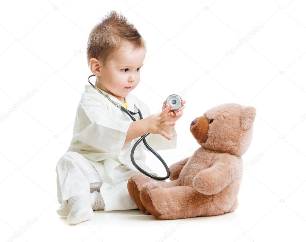Kid Or Child Playing Doctor With Stethoscope And Teddy