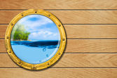 Ship porthole with tropical landscape and underwater behind — Stock Photo
