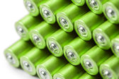 Green AAA or AA batteries stack — Stock Photo