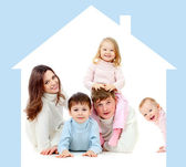 Happy family in own home concept — Stock Photo