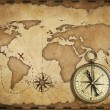 Aged brass antique nautical compass and old map with track on it — Stock Photo