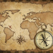 Stock Photo: Aged brass antique nautical compass and old map with track on it