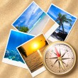Traveling photos with compass on sand beach — Stock Photo