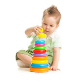 Cute boy playing colorful tower isolated on white — Stock Photo