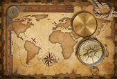 Aged treasure map, ruler, rope and old brass compass with lid — Stock Photo