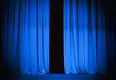 Blue stage curtain slightly open — Stock Photo
