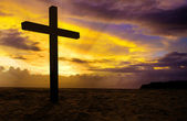 Christian cross on sunset background — Stock Photo