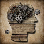 Human brain work metaphor made of rusty metal gears — Stockfoto